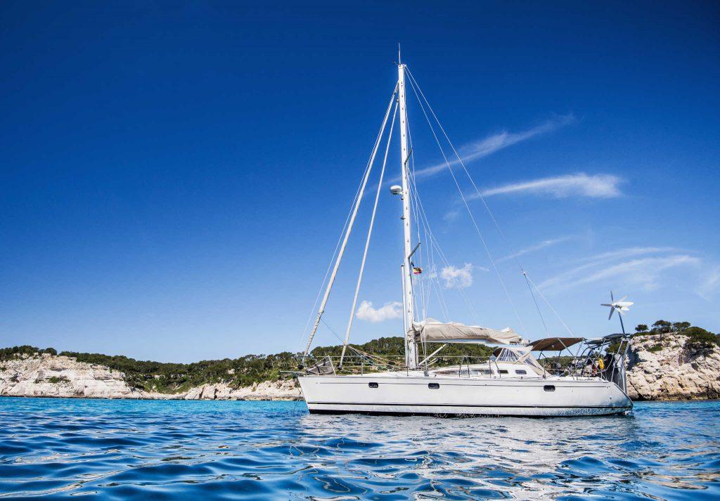 Beautiful bay with sailing boat in Mediterranean sea.