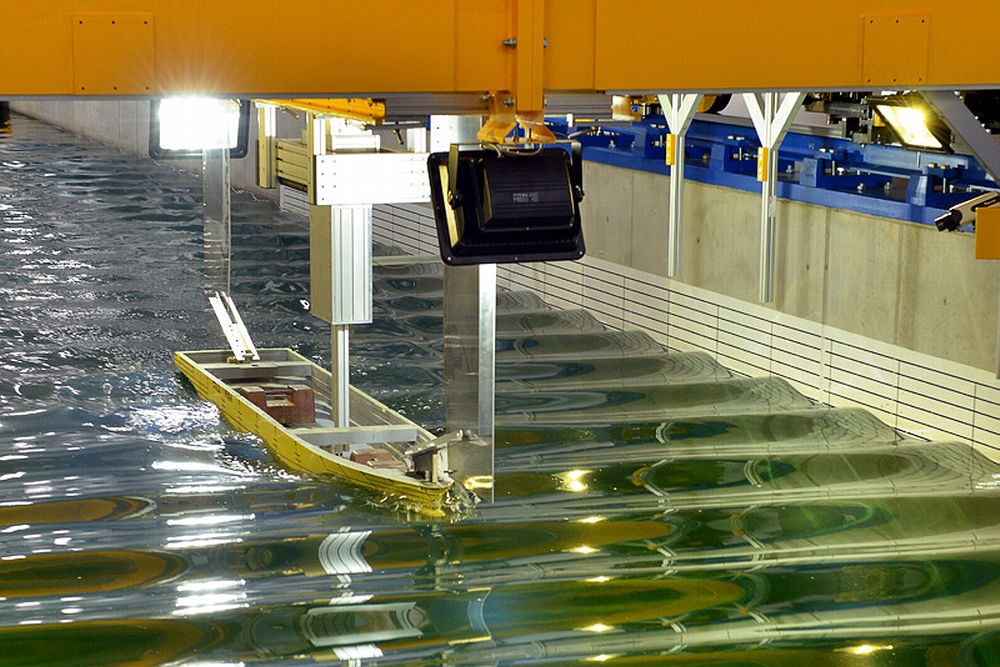 Hull model being tested in a test tank.
